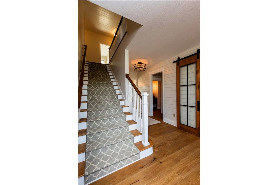 Entry Hall: Staircase of this 5-Bedroom,4724 Sq Ft Plan -101-2006