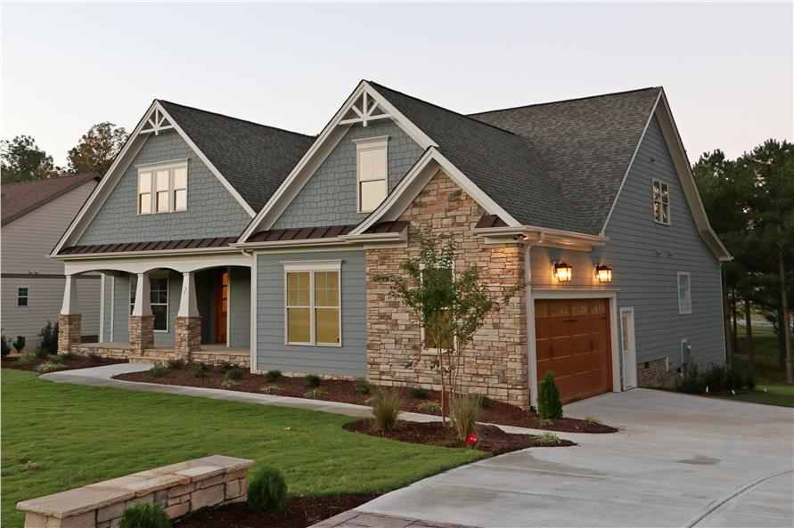 Photo of front exterior of this winning Craftsman home (ThePlanCollection: House Plan #104-1064)