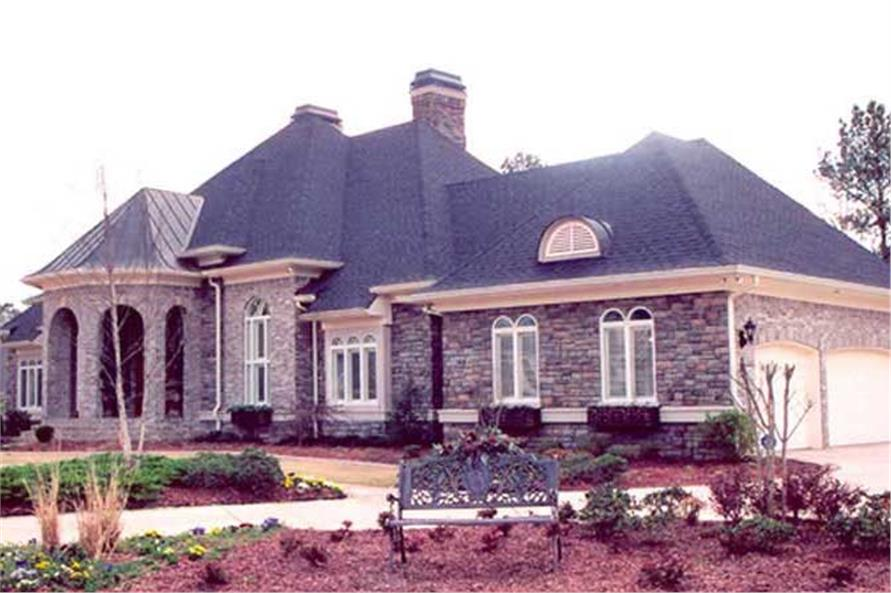 Front elevation of Luxury home (ThePlanCollection: House Plan #106-1165)