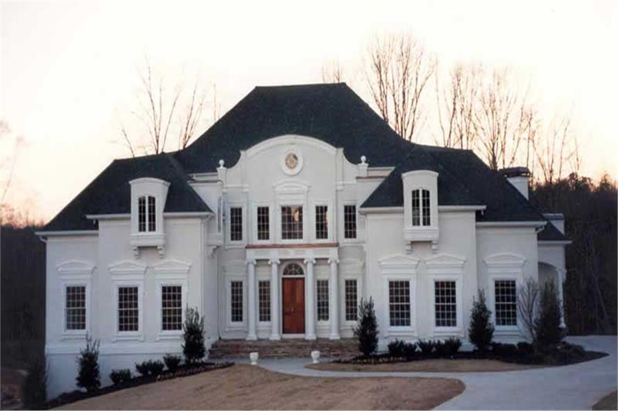 Imposing 2 Story Luxury Home Design In White With Columns On The Front  Porch,
