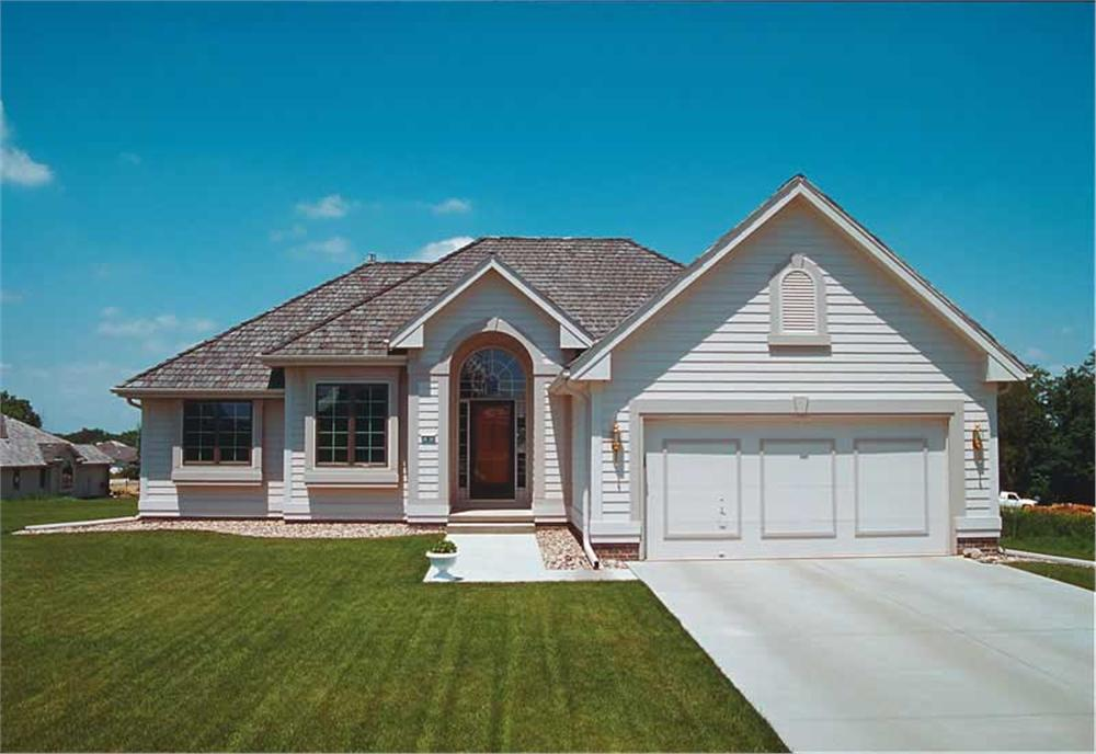Front elevation of Ranch home (ThePlanCollection: House Plan #120-1544)