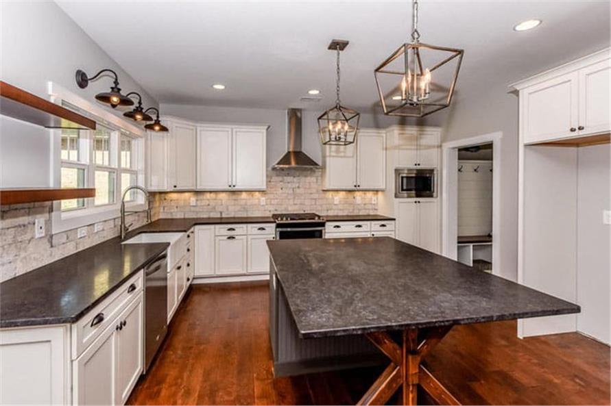 Kitchen: Breakfast Bar of this 4-Bedroom,2607 Sq Ft Plan -120-2230