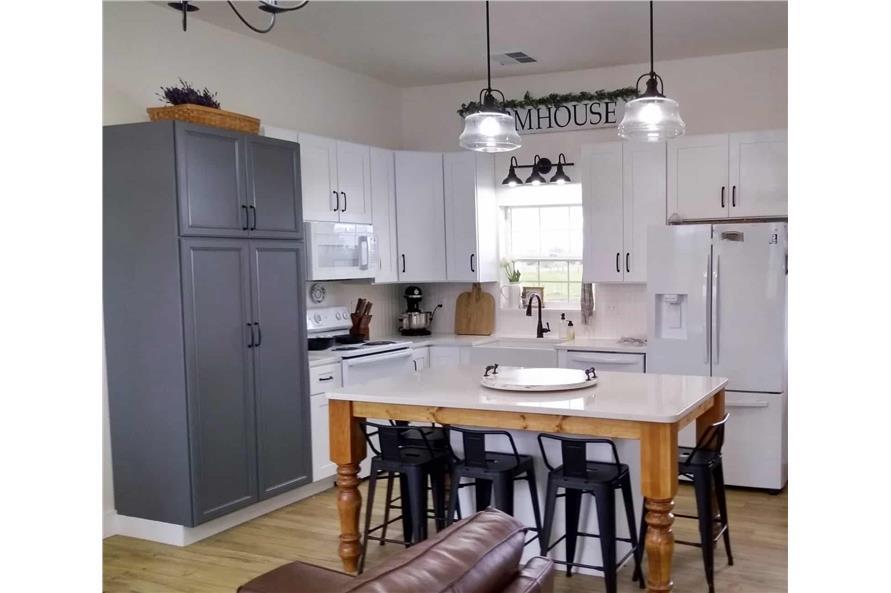 Kitchen: Kitchen Island of this 3-Bedroom,1035 Sq Ft Plan -123-1116