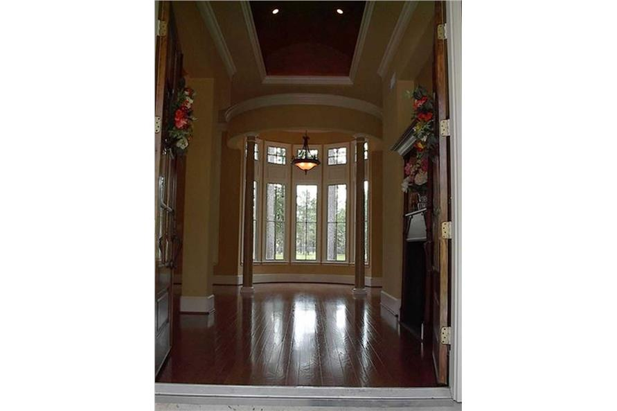 Home Interior Photograph-Entry Hall: Foyer with rotunda at rear.