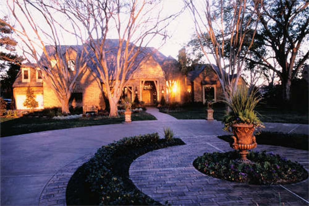 Luxury estate home at sunset.