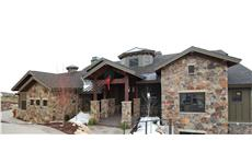 Photo of this luxury Craftsman house plan