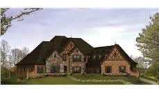 Front elevation of Tudor home (ThePlanCollection: House Plan #138-1215)