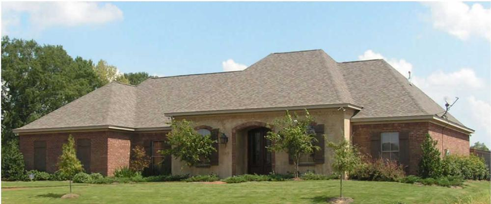 This is a color photo of these French Country House Plans.
