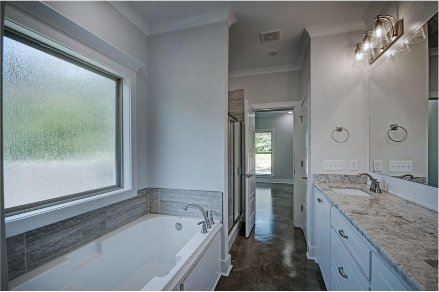 Master Bathroom: Tub of this 3-Bedroom,1581 Sq Ft Plan -1581