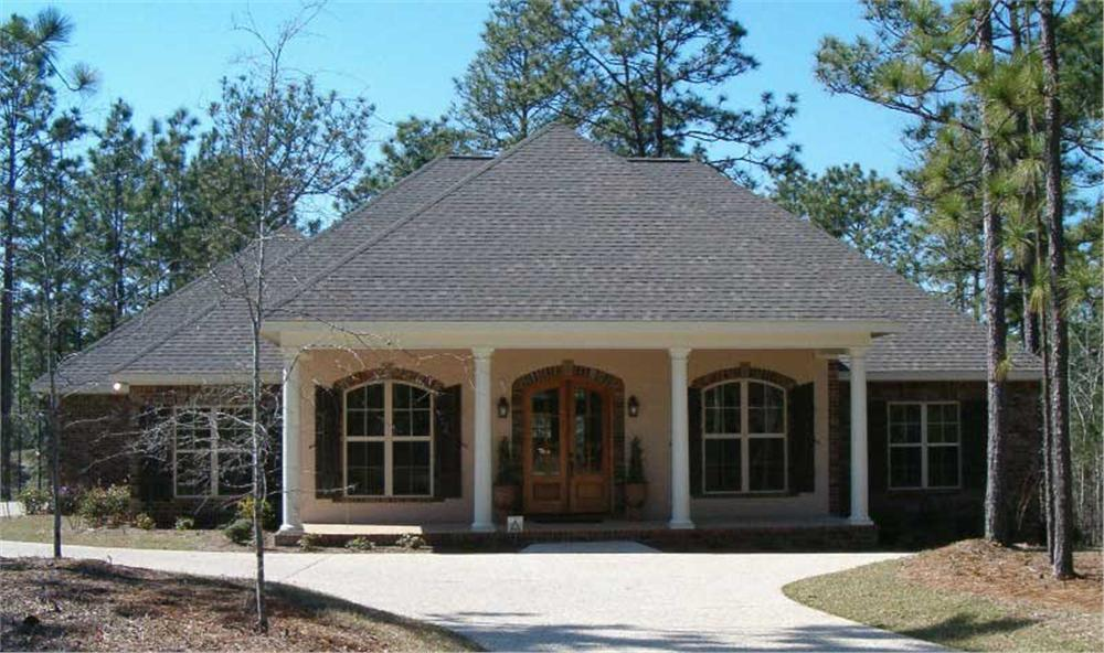 This is a color photo of these Acadian Houseplans.