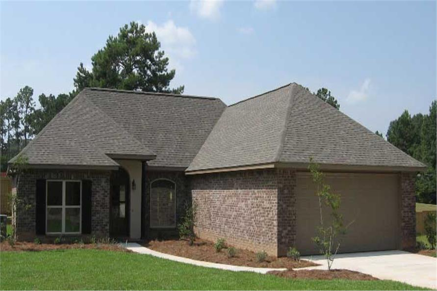 This image is a colored photo of the front of these House Plans.