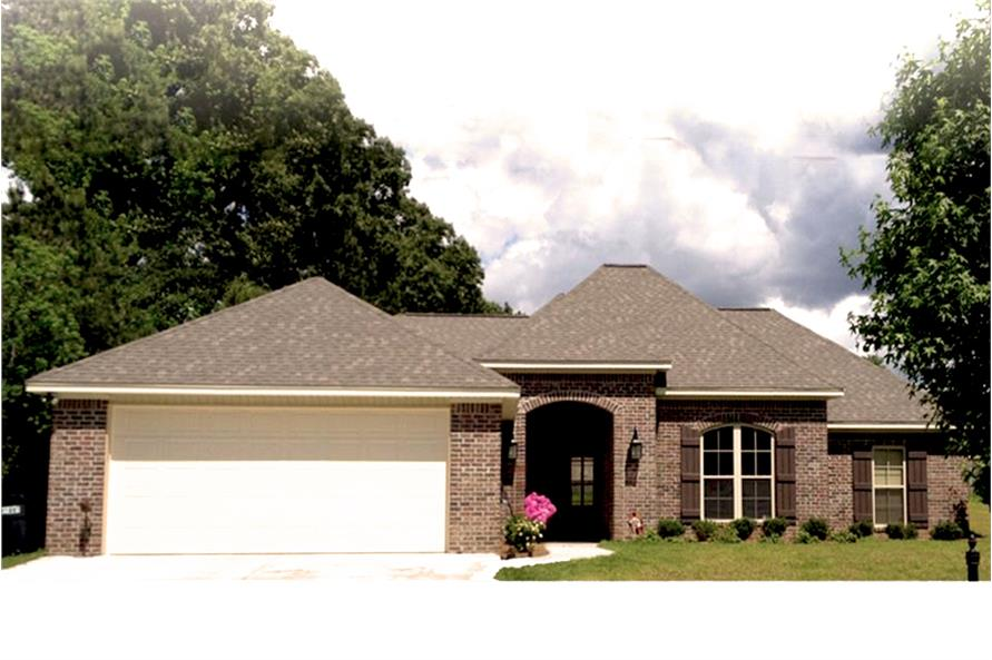 Color photo of Acadian home plan (House Plan #142-1070) at The Plan Collection.