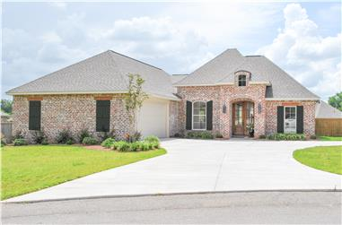 Front Elevation Photo of this Acadian House (#142-1089) at The Plan Collection.