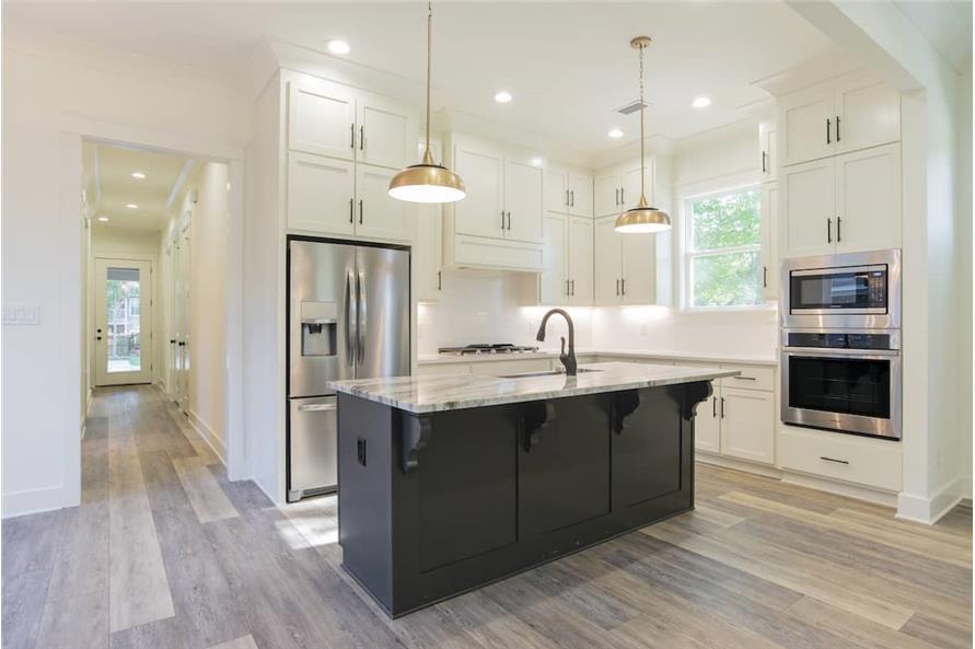 Kitchen: Breakfast Bar of this 4-Bedroom,2184 Sq Ft Plan -142-1128