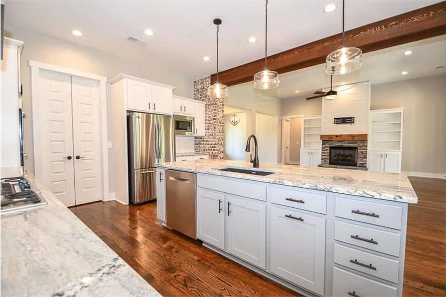Kitchen: Kitchen Island of this 3-Bedroom,2469 Sq Ft Plan -142-1166