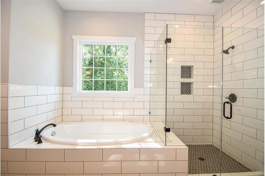 Master Bathroom: Tub of this 3-Bedroom,2469 Sq Ft Plan -142-1166
