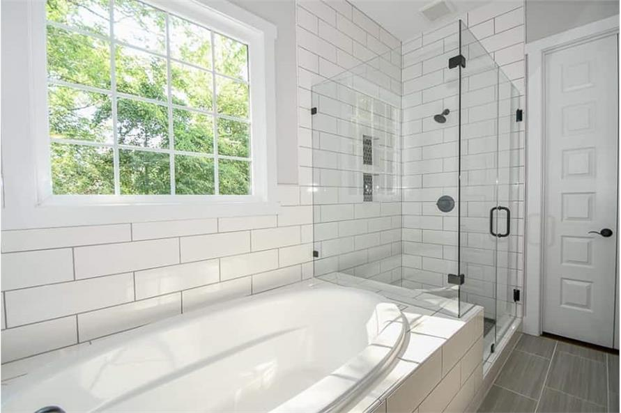 Master Bathroom: Shower of this 3-Bedroom,2469 Sq Ft Plan -142-1166