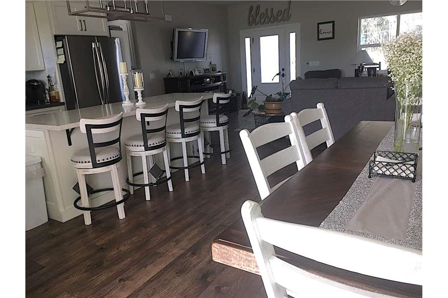 Kitchen: Breakfast Bar of this 3-Bedroom,1657 Sq Ft Plan -142-1176