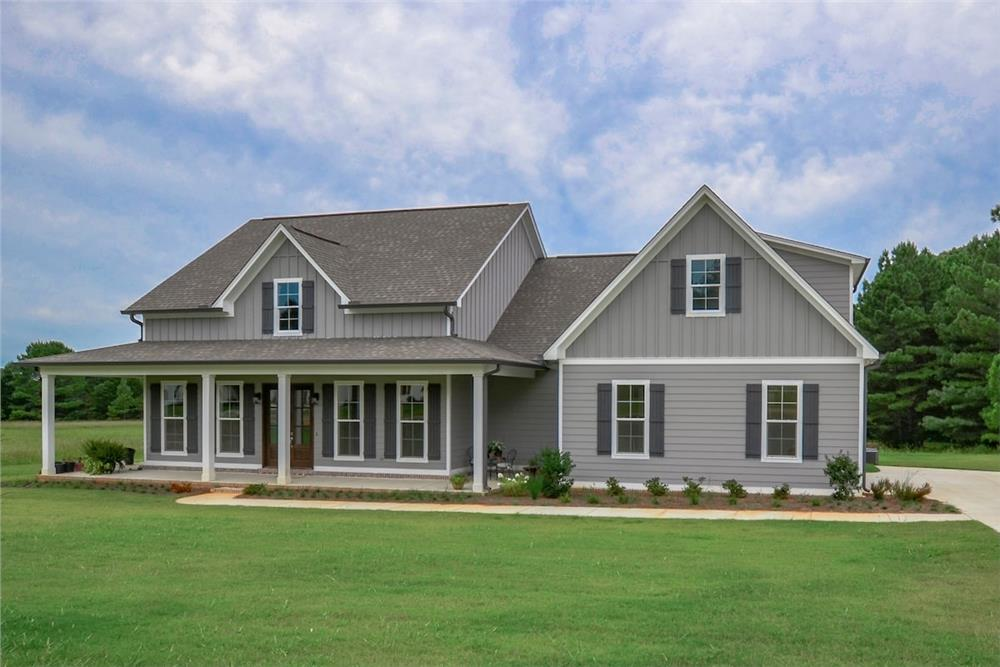 Front elevation of Farmhouse home (ThePlanCollection: House Plan #142-1180)