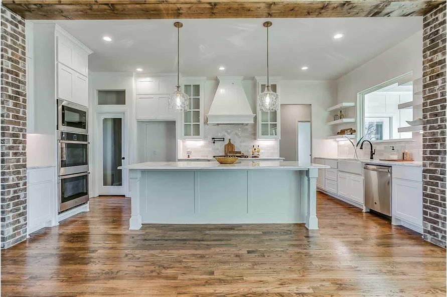 Kitchen: Kitchen Island of this 4-Bedroom,2390 Sq Ft Plan -142-1231