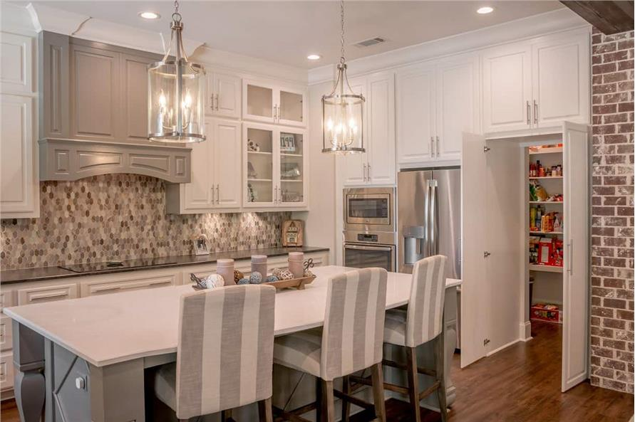 Kitchen: Kitchen Island of this 3-Bedroom,2553 Sq Ft Plan -142-1233