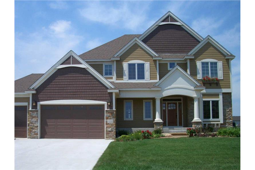 This color photo shows the front elevation of these Traditional Homeplans.