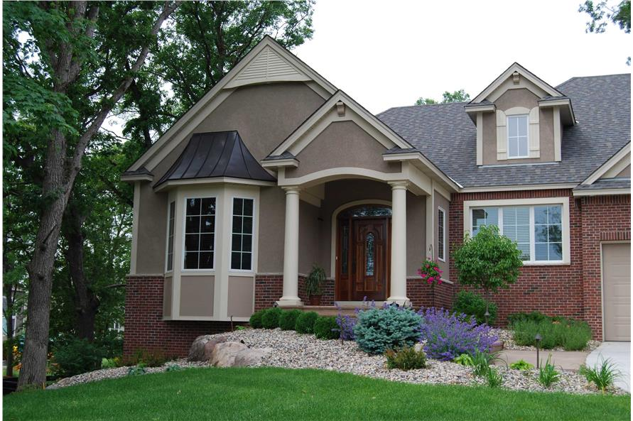 This is a color photo showing the front elevation of these Traditional Home Plans.