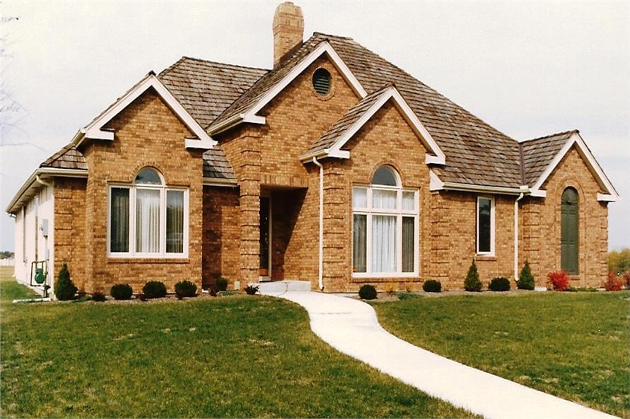Color photo of European home plan (ThePlanCollection: House Plan #147-1101)