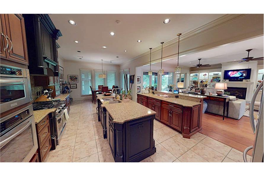 Kitchen: Kitchen Island of this 4-Bedroom,3766 Sq Ft Plan -153-1095