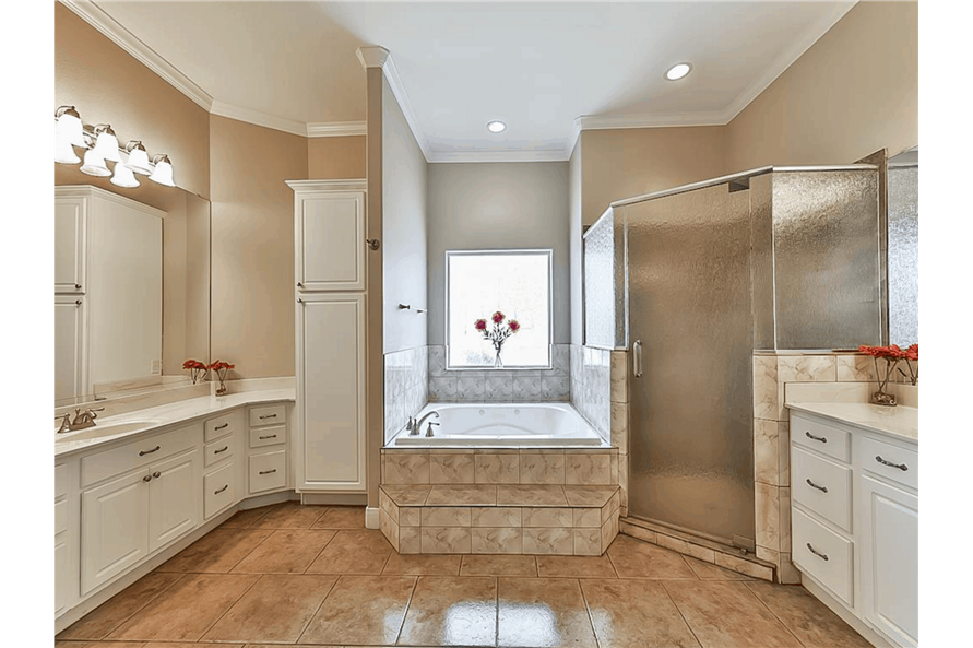 Master Bathroom: Tub of this 4-Bedroom,3021 Sq Ft Plan -153-1209