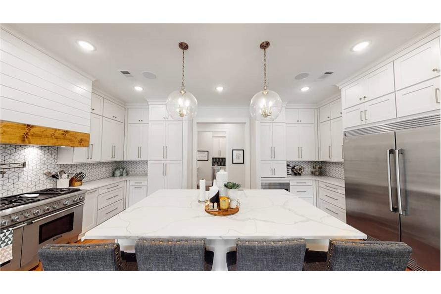 Kitchen: Breakfast Bar of this 4-Bedroom,4488 Sq Ft Plan -153-1365