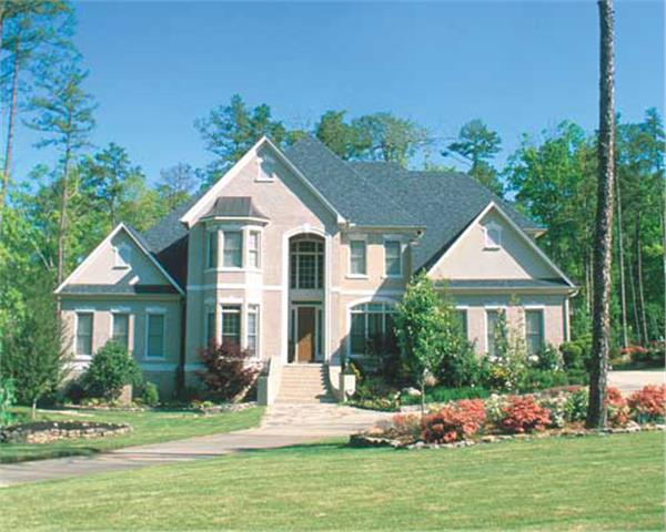 Luxurious, traditional home with brick exterior.