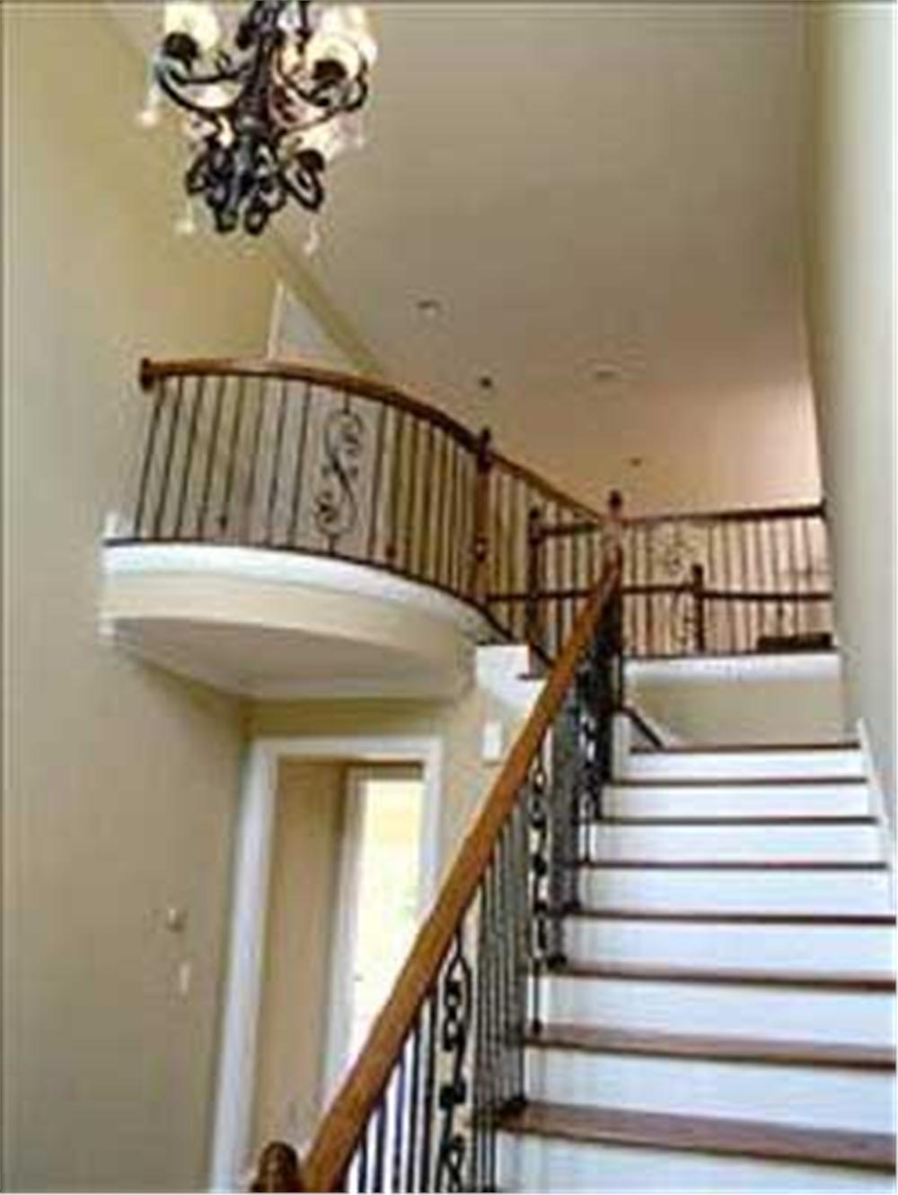 interior photo of plan 9232 foyer stairs