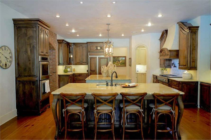 Kitchen: Breakfast Bar of this 6-Bedroom,6004 Sq Ft Plan -153-1945