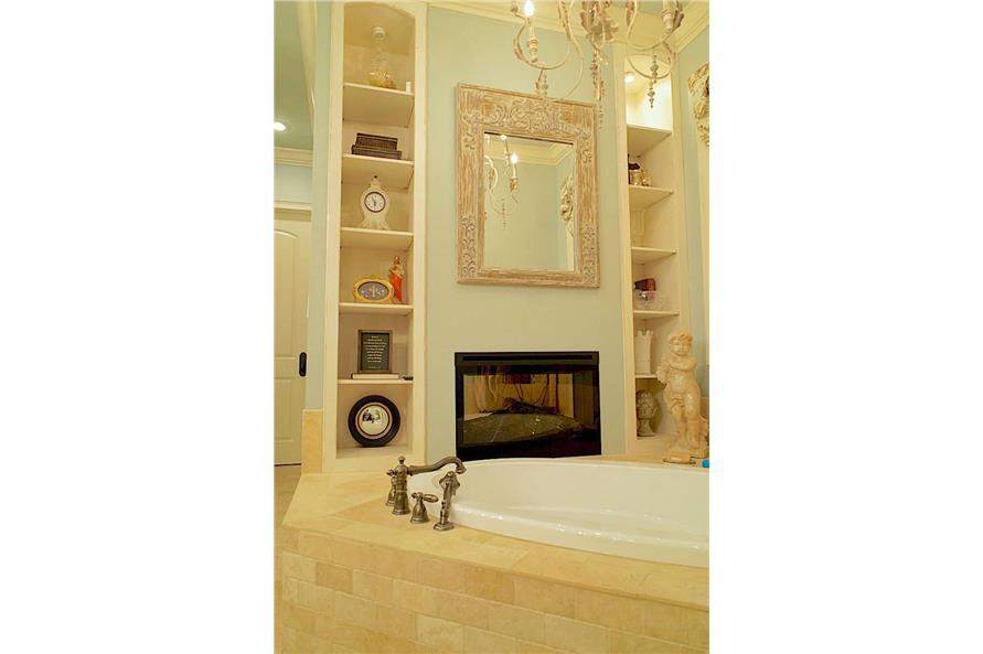 Master Bathroom: Tub of this 6-Bedroom,6004 Sq Ft Plan -153-1945