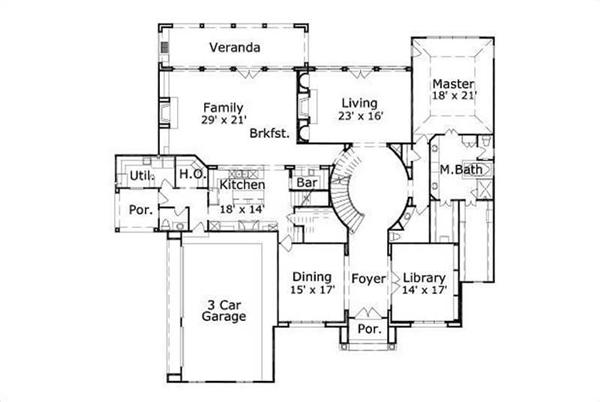 This image shows the living and dining areas along with the 2 car garage.
