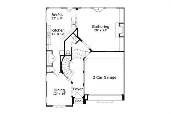 This image shows the kitchen and dining areas along with the 2 car garage.