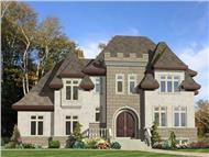 This image shows the front elevation for these European castle House Plans.