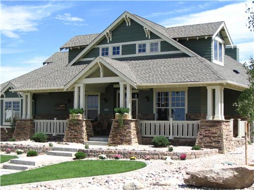 This is a color photo of these Craftsman Homeplans.