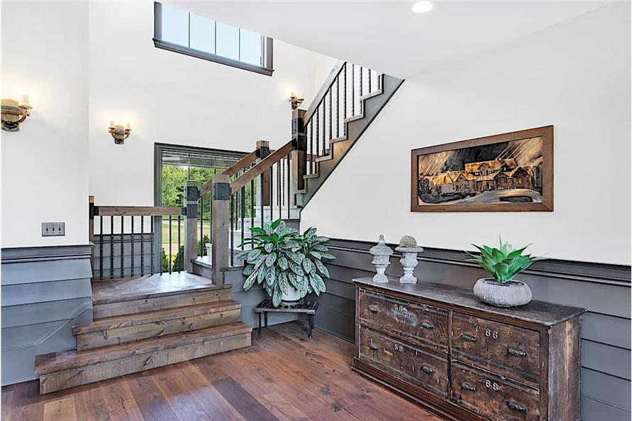 Entry Hall: Staircase of this 5-Bedroom,5164 Sq Ft Plan -161-1003