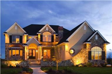 Front image of House Plan #161-1030 at night.