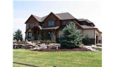 This is the front elevation photo for these Mountain House Plans.