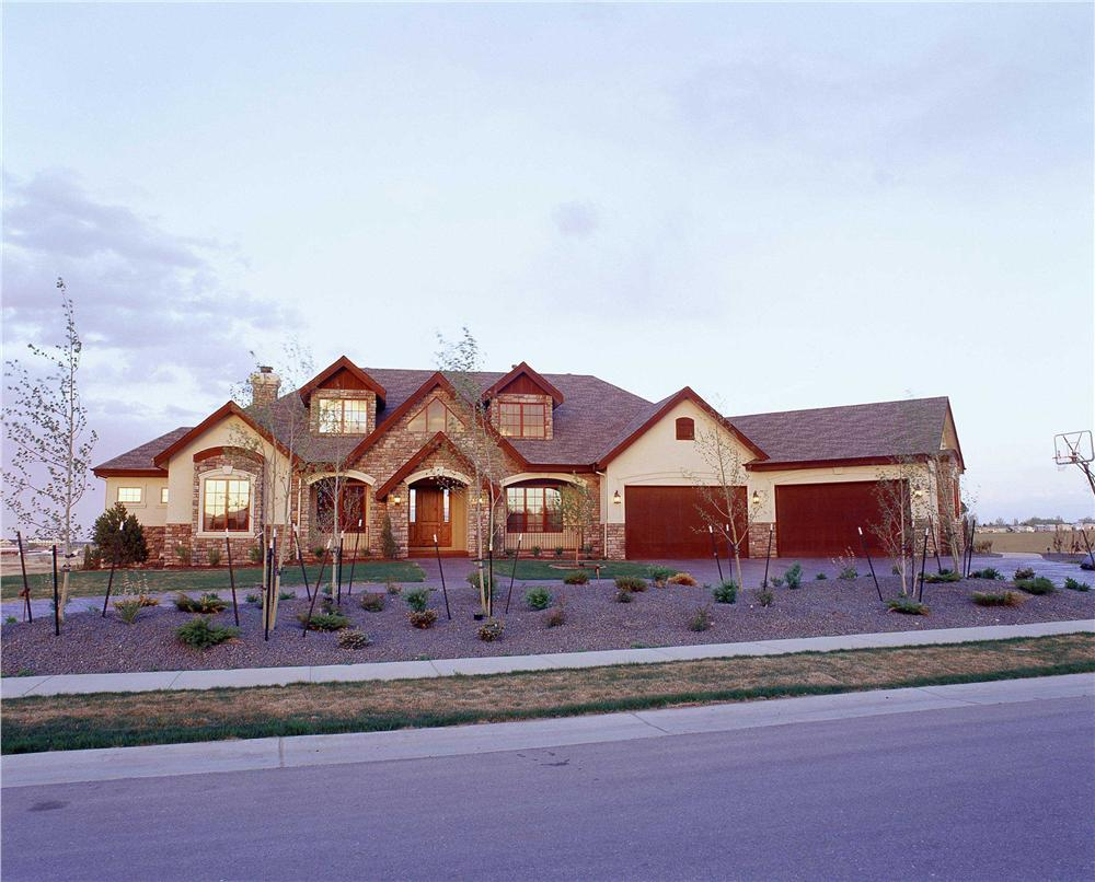 This is a color photo of these Country House Plans.