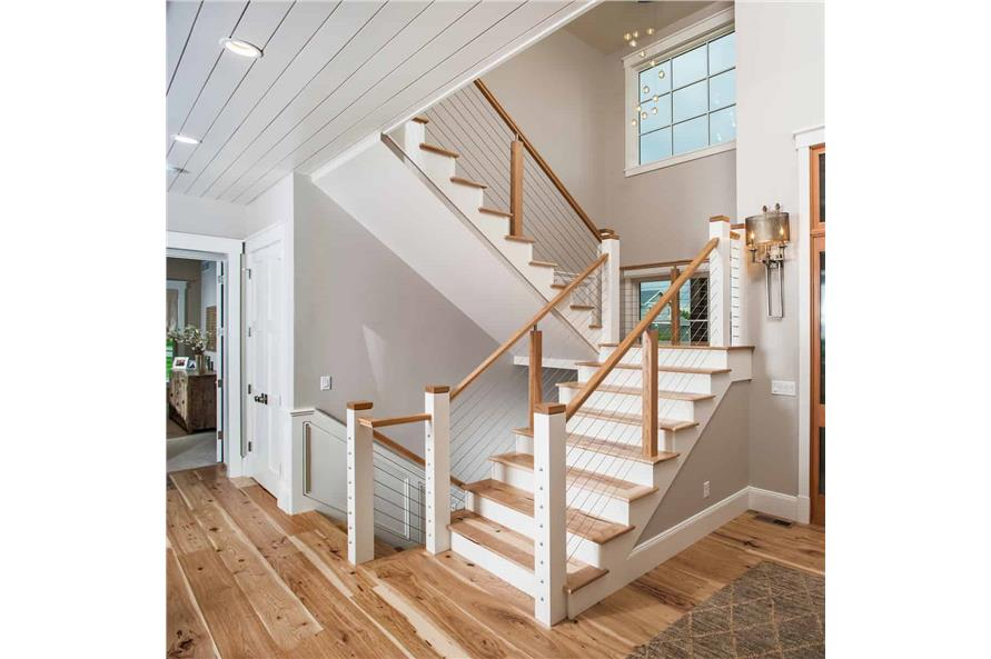 Entry Hall: Staircase of this 5-Bedroom,4784 Sq Ft Plan -4784