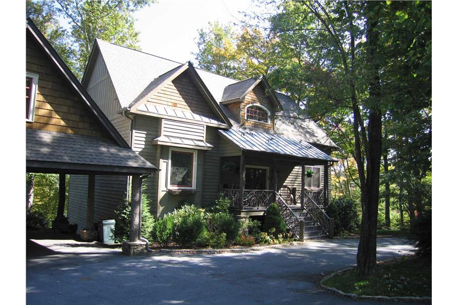 This is a color photo for these Craftsman Home Plans.