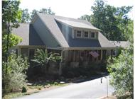 This is a color photo of these Craftsman Home Plans.