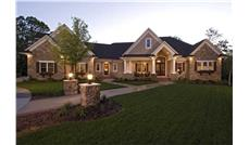 Luxury House plan 165-1077 photo of front elevation at dusk.
