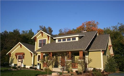 This photo shows the front elevation of these charming Craftsman Home Plans.