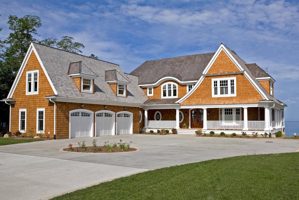 Front elevation of Shingle home (ThePlanCollection: House Plan #168-1132)