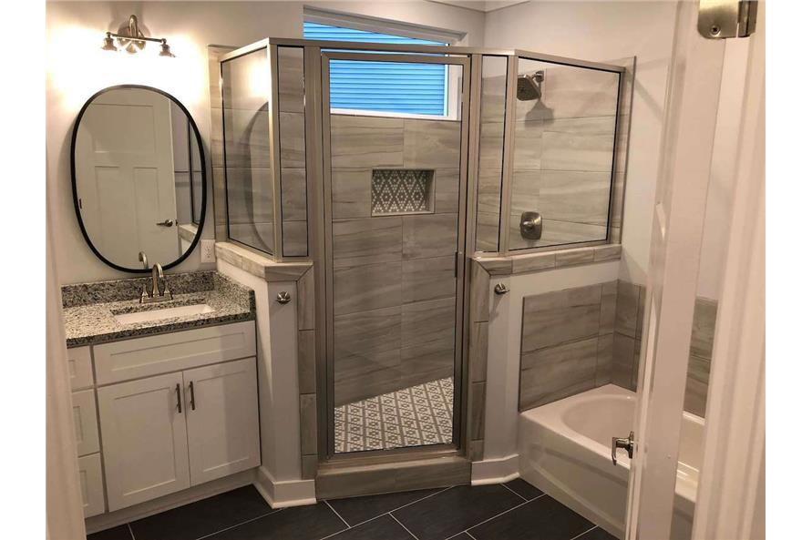 Dazzling master bathroom with walk-in shower and tub